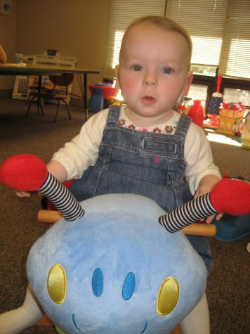 Look at me on the big bug in the church playroom! -