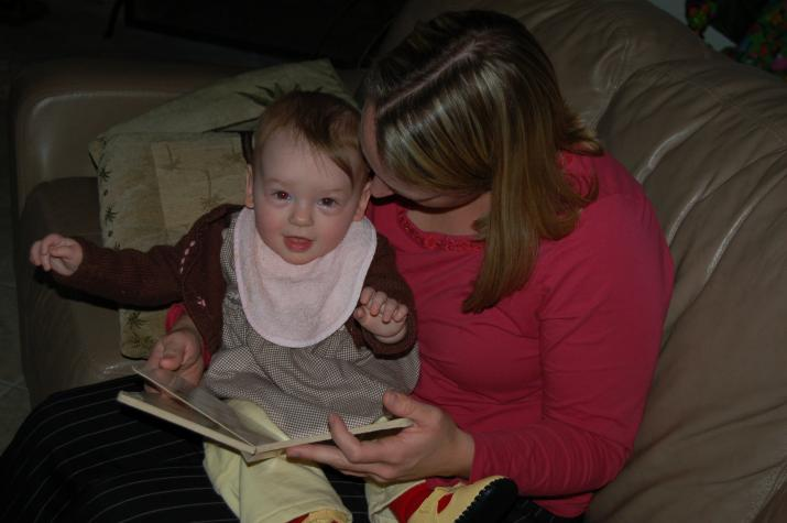 Reading with mommy.  She reads, I turn the pages. -